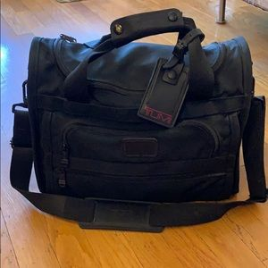 Tumi carry case with shoulder strap